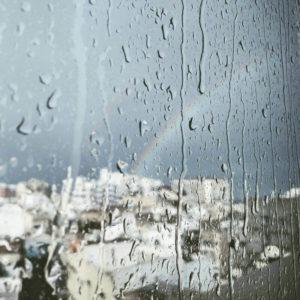 rainbow outside a window